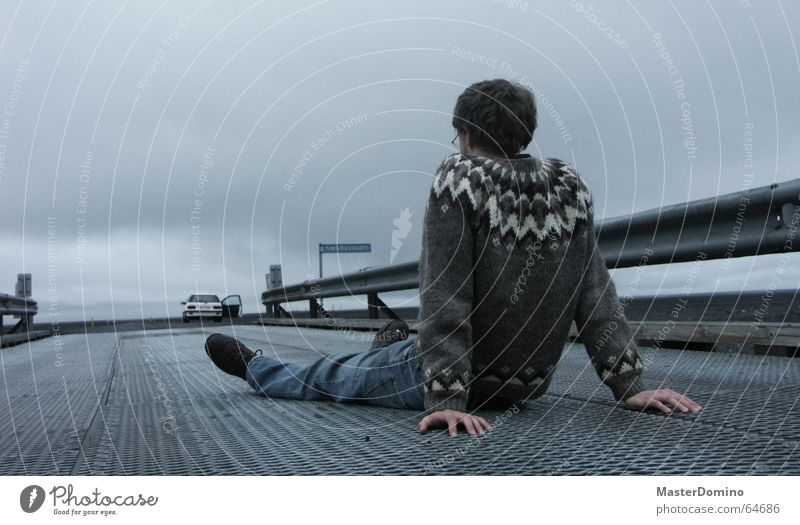 Then go on alone! Man Support Hand Crash barrier Gray Clouds Horizon Bad weather Street sign Carriage Loneliness Far-off places Sweater Iceland Grief Dreamily