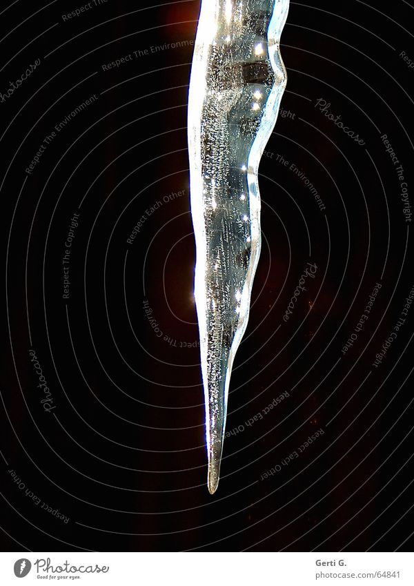 the tip of an icicle protrudes into the picture against a black background Black White Icicle Frozen Hang Freeze Ice age Dark Winter Feeble Glittering Frost