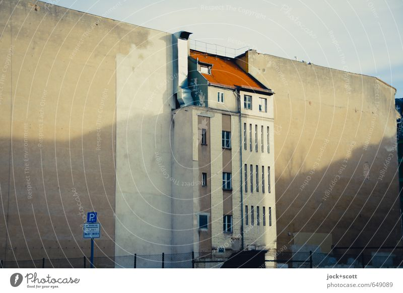 Centrally located Sky Downtown Berlin Facade Fire wall Ventilation shaft Road sign Historic Change Shadow play Diagonal Stick out Wire netting fence
