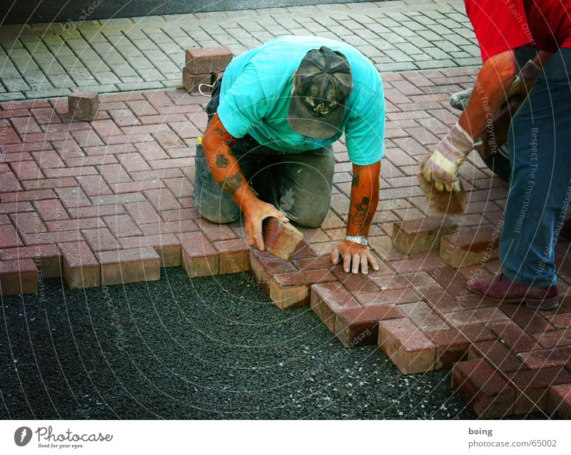 Work and employment Stone Concrete Future Working man Construction site Lie Forwards Touch Craft (trade) Sidewalk Traffic infrastructure Cobblestones Parking lot Gravel Construction worker