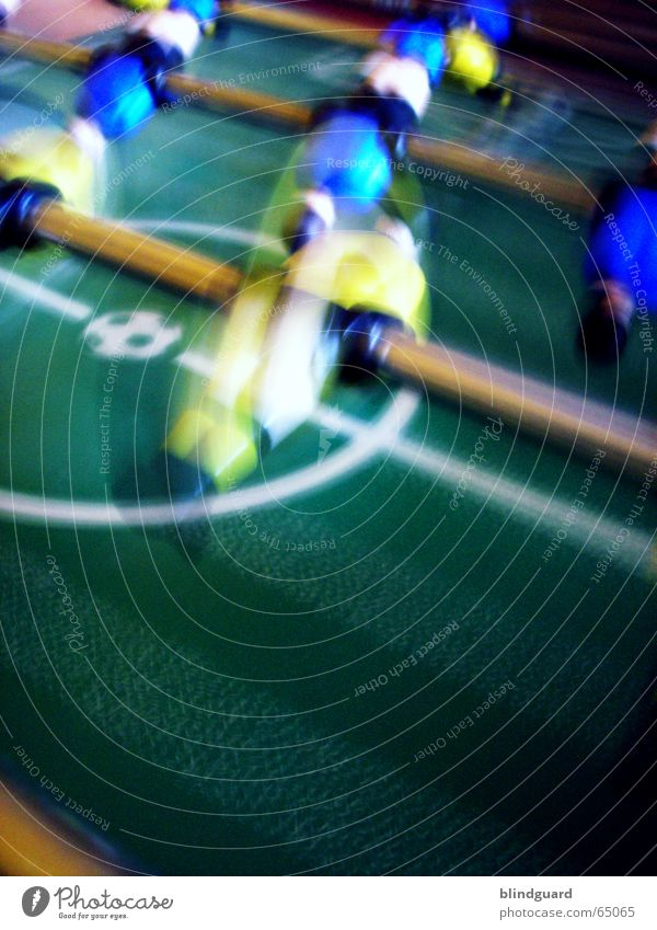 I'm freaking out. Table soccer Rotate Playing Leisure and hobbies Green Yellow Sports Blue Movement Rod Motion blur Rotation Rotated Blur Speed Colour photo