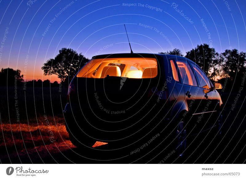 Lonely night ride Night Night journey Motor vehicle Bright Tree Blue Antenna Wheel rim Aluminium Sunset Lower Saxony Germany Night shot Car 9n Seating silhoutte