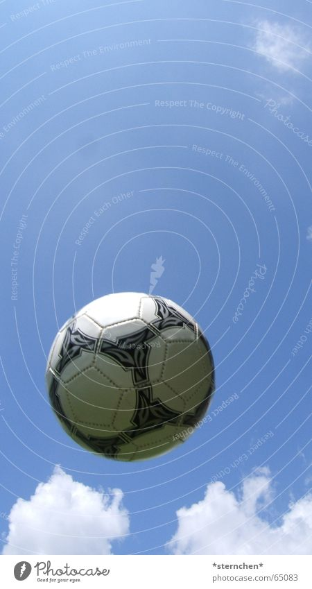 High in the air Soccer Ball Sky Clouds Flying Throw Bright Round Blue Black White Exterior shot