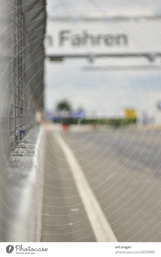 Driving Motorsports Racecourse Speed Athletic straight Speedway race racetrack Colour photo Exterior shot Deserted Blur Central perspective