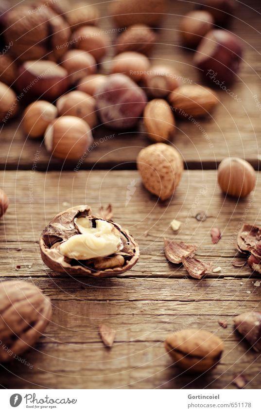 walnut Nutrition Organic produce Vegetarian diet Slow food Finger food Healthy Brown Walnut Almond Hazelnut Wooden table Food photograph Christmas & Advent