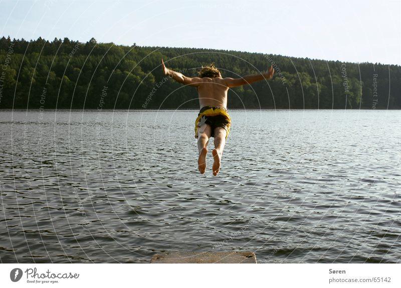 Water Vacation & Travel Sun Ocean Beach Joy Forest Jump Lake Feet Orange Back Footbridge Hover Hop Swimming trunks