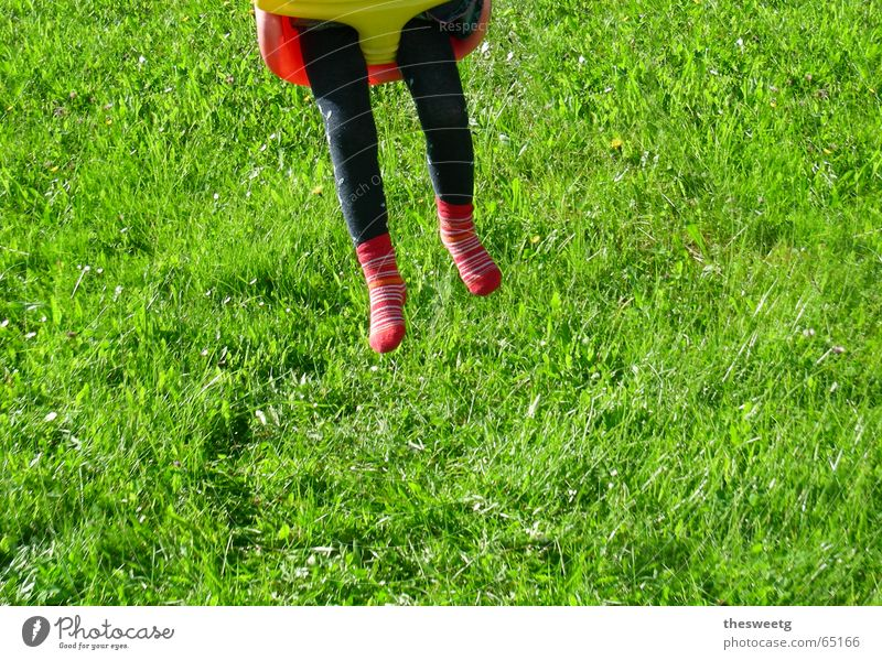 taken for a ride Playground Child Swing Girl Boy (child) Childlike Spirited Aloof Airy huitschn Legs Lawn Wing romping place child's swing Bump Driving