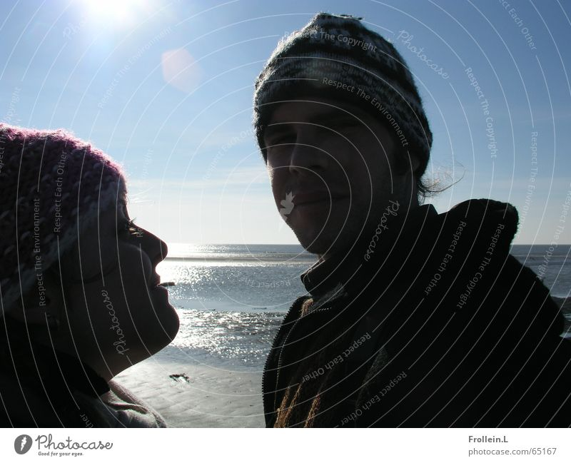 Julia and Jörg Ocean Beach Winter February St. Peter-Ording Cap Sunday Dazzle Back-light Wink Love Light Water Couple sea shadow Lovers Together Relationship
