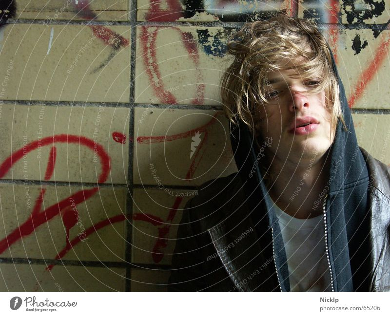Tim II Masculine Beautiful Dirty Man Wall (building) Smeared Multicoloured Disgust Greasy Leather jacket Brown Black Fat Tramp Junkie Portrait photograph Blonde