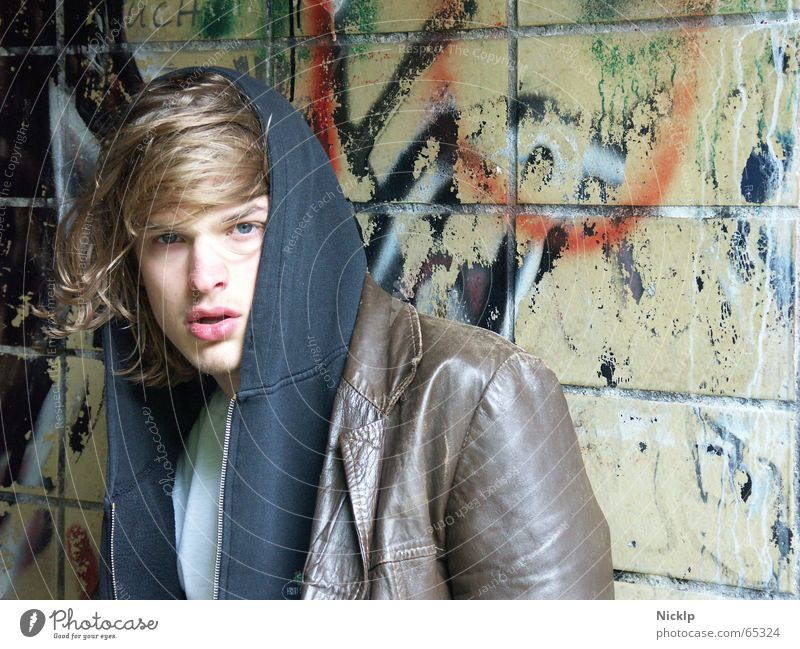 Tim VI Haste Masculine Beautiful Dirty Man Wall (building) Smeared Multicoloured Disgust Greasy Leather jacket Brown Black Fat Tramp Junkie Portrait photograph