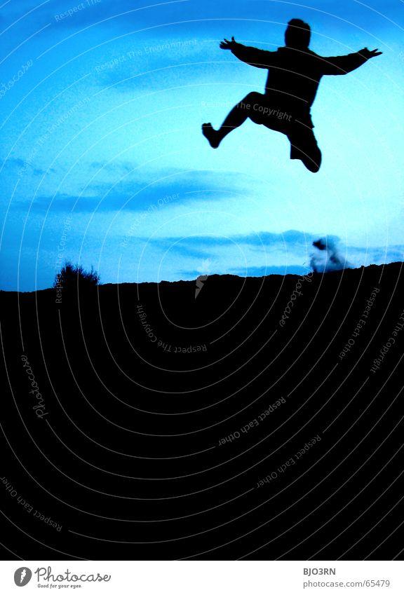 Human being Sky Man Hand Blue Joy Black Colour Freedom Emotions Jump Sand Legs Arm Flying Lifestyle
