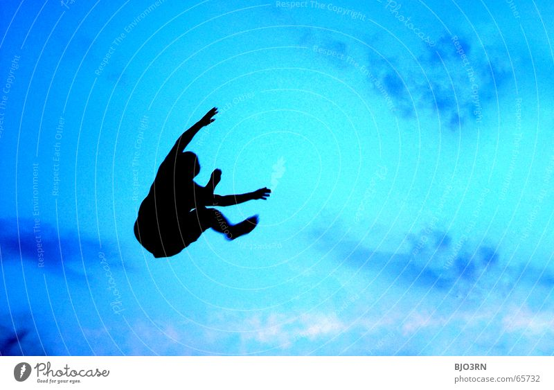 Human being Sky Man Blue Colour Hand Joy Black Adults Emotions Freedom Sand Jump Legs Flying Lifestyle