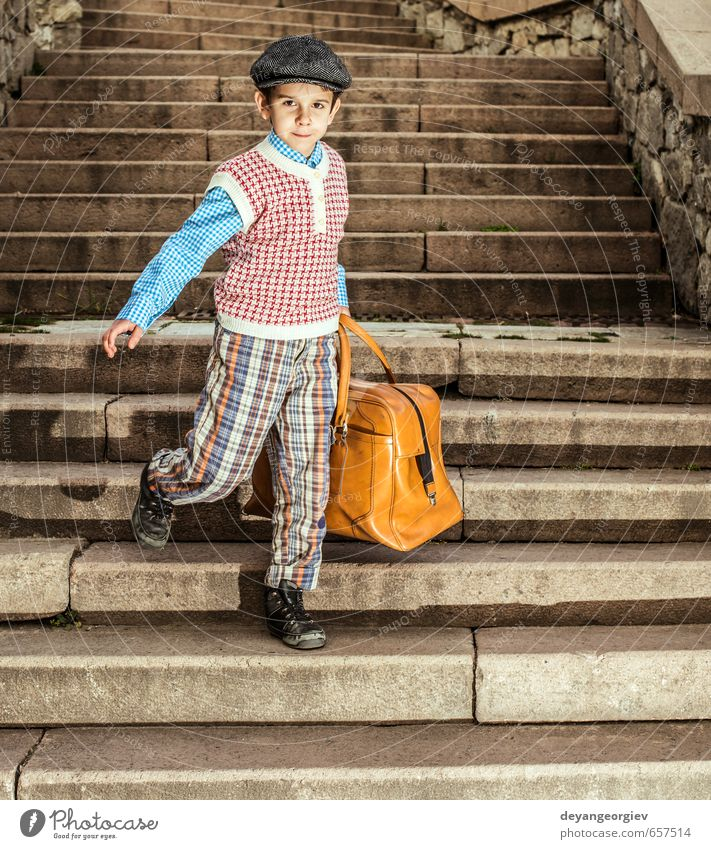 Exterior stairs and child with vintage bag Vacation & Travel Trip Child School Human being Boy (child) Infancy Street Suitcase Small Retro Black White kid