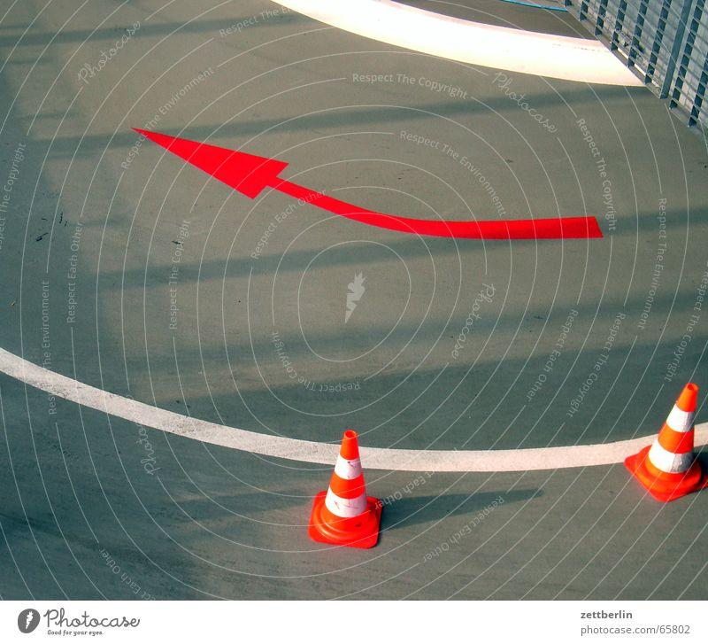 underground car park Underground garage Garage Lane markings Red White Gray Traffic cone Arrow Line Gate Door