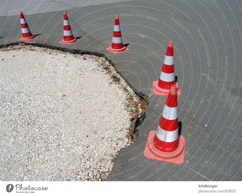 Attention in traffic! Street sign Road sign Stand Beaded Transport Detour Hat Traffic accident Asphalt Gravel Hard Broken Pothole Torn Striped Reddish white