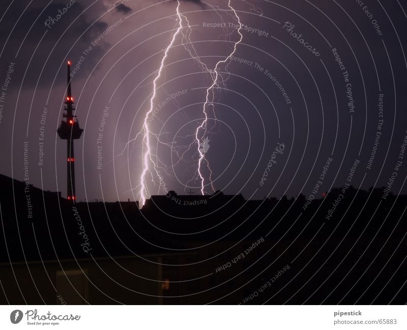 Lightning next to the Mannheim television tower Violet Yellow Sunset Town Petrol station Pink High-rise Sky Weather Hail