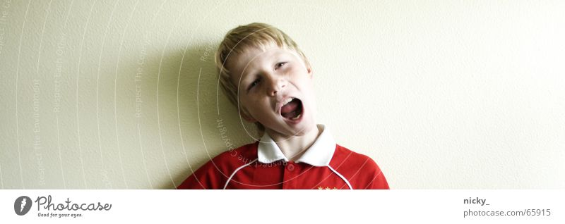 Child Red Face Eyes Boy (child) Wall (building) Hair and hairstyles Head Wall (barrier) Mouth Funny Nose Crazy T-shirt Anger Scream