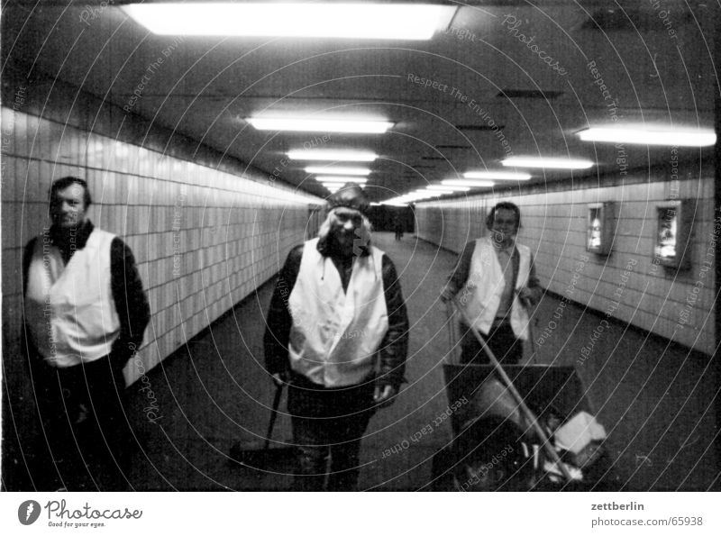People in the tunnel Tunnel Cleaner Neon light Vanishing point Central Underpass city cleaning spotting requirement