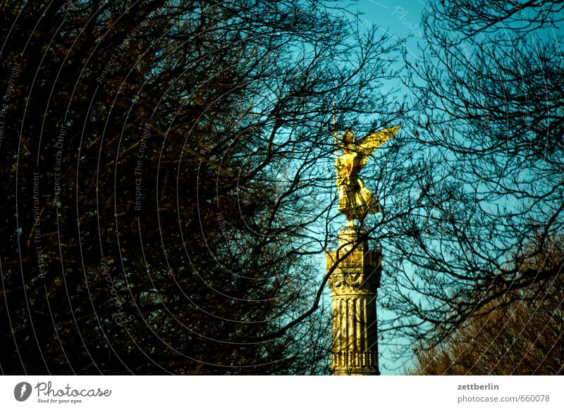 Victory column behind trees Berlin Monument Gold Goldelse victory statue big star Capital city Sky Tourist Attraction Berlin zoo Victoria Landmark Cloudless sky