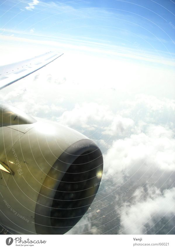 Sky Blue Vacation & Travel Clouds Air Airplane Trip Aviation Vantage point Longing Airport Wanderlust In transit Homesickness View from a window Window seat