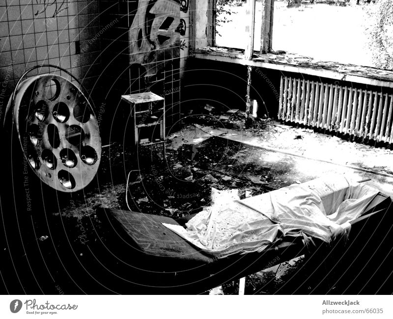 The Black and White Clinic Surgery Sanatorium Dark Dirty Hospital Smeared Disgust Rain Broken Shard Building rubble Couch Ruin Untidy Interior shot Creepy Tile