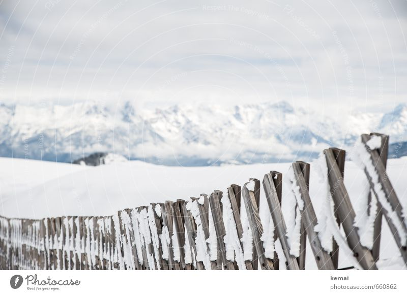 Along the fence Environment Nature Landscape Clouds Ice Frost Snow Mountain Snowcapped peak Fence Wooden fence Barrier Bright Cold White Frozen Colour photo