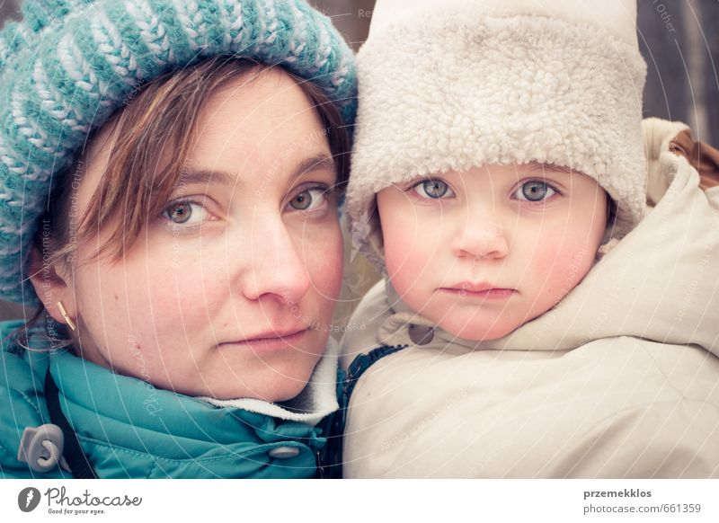 Portrait of mom and daughter at freeze day Human being Woman Child Girl Winter Adults Warmth Love Together Family & Relations Infancy Authentic Cute Mother Cap Freeze