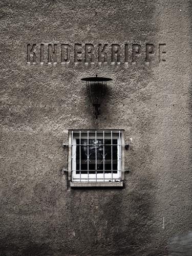 Mama? Parenting Education Kindergarten crib Child Baby Toddler Wall (barrier) Wall (building) Facade Window Grating Old Dirty Dark Creepy Hideous Gray Pain