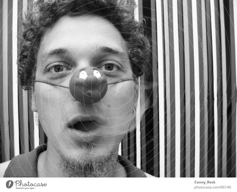 Smoking clown without a crown Carnival fool Cigarette Circus Grief Facial hair Breath Stripe Pattern Striped Vertical Impish Portrait photograph Man Clown Smoke