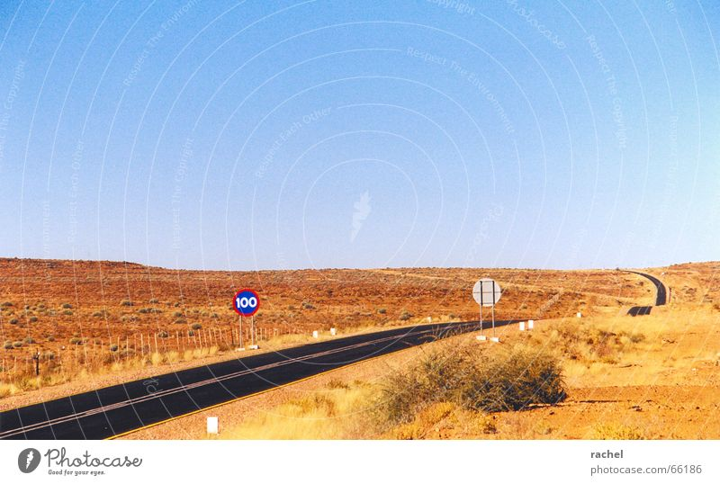 Vacation & Travel Loneliness Far-off places Horizon Empty Travel photography Asphalt Beautiful weather Africa Desert Blue sky Steppe Cloudless sky Badlands Road sign Country road