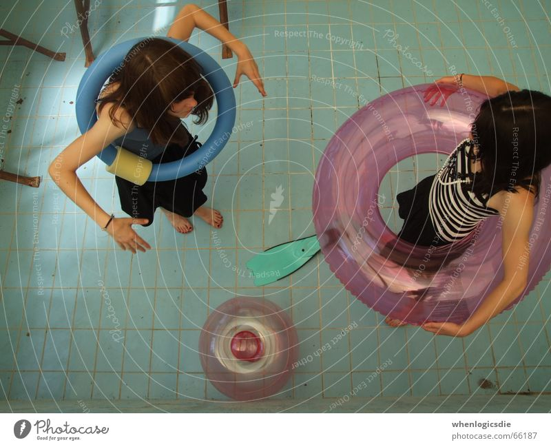joke. Swimming pool Empty 2 Girl Bird's-eye view Circle Water wings Blue