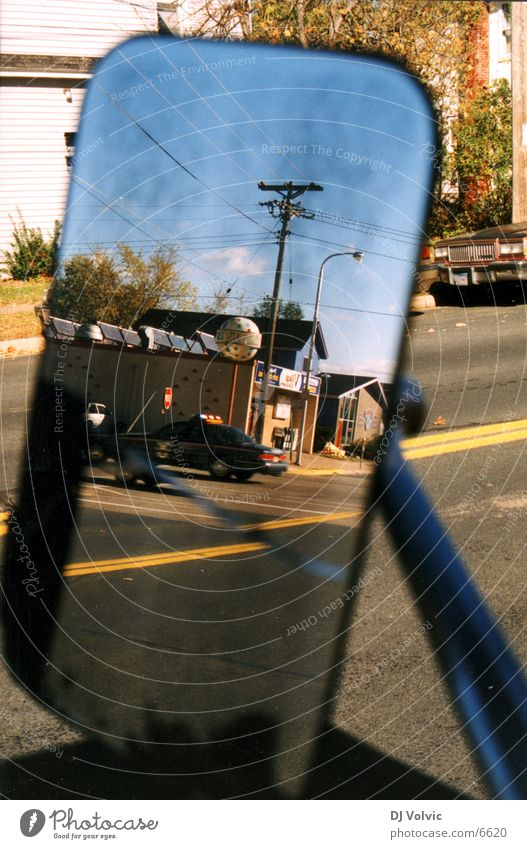 main street Reflection Delivery truck Mirror Rear view mirror Small Town Electricity pylon North America Traffic infrastructure Signage police car USA Street