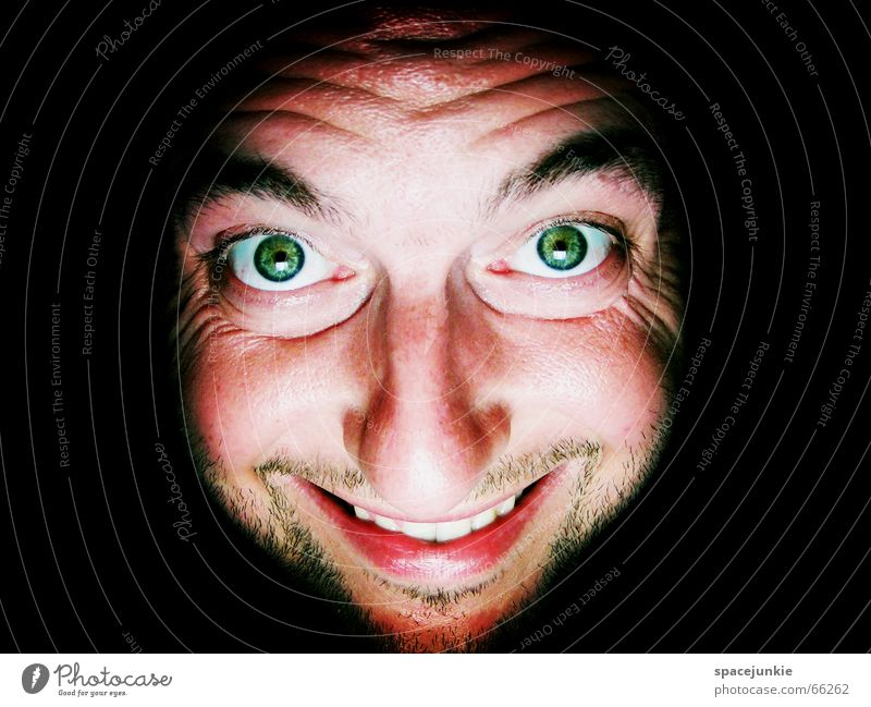 The heat is driving me crazy! Physics Man Portrait photograph Crazy Freak Dark Black Green Warmth Face Grinning Eyes Mouth Human being Looking