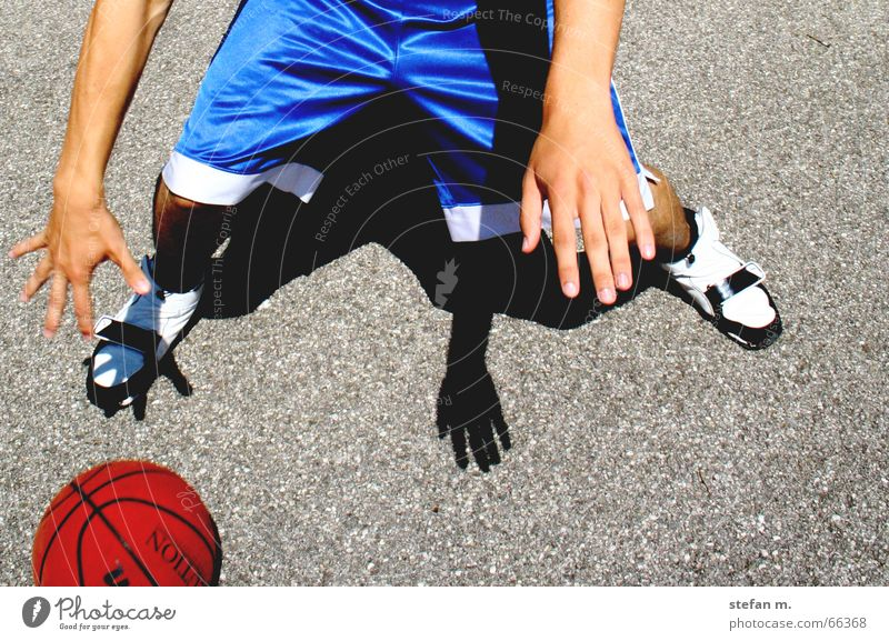 back and forth Dribbling Playing Hand Pants Asphalt Basketball streetball move Movement Sports Joy Sun Shadow Ball Blue
