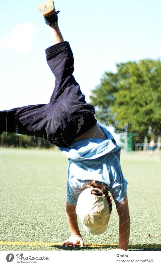 Handstand I Child Masculine Acrobat Gymnastics Boy (child) Artificial lawn Tree Bushes Meadow Clouds Summer Hot Physics Lawn Sky Blue Sun Warmth Movement Joy