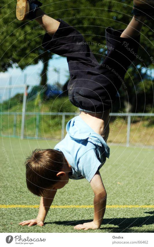 Handstand II Child Masculine Acrobat Gymnastics Boy (child) Artificial lawn Tree Bushes Meadow Clouds Summer Hot Physics Fence Splits Lawn Sky Blue Sun Warmth