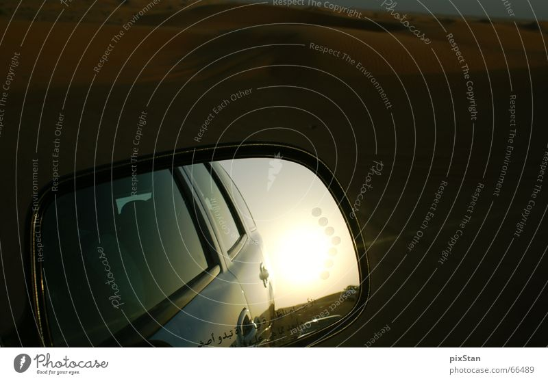 objects in the mirror are closer than they appear..... Rear view mirror Mirror Arabia Dubai Sunset Car Characters Desert Sand Evening