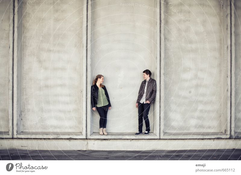 DUO Masculine Feminine Young woman Youth (Young adults) Young man Friendship Couple 2 Human being 18 - 30 years Adults Town Gray Colour photo Exterior shot