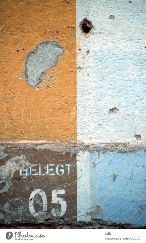 Colour Wall (building) Wall (barrier) Line Brown Orange Characters Digits and numbers Image Square Illustration Plaster Surface Graphic Sharp-edged Paintwork