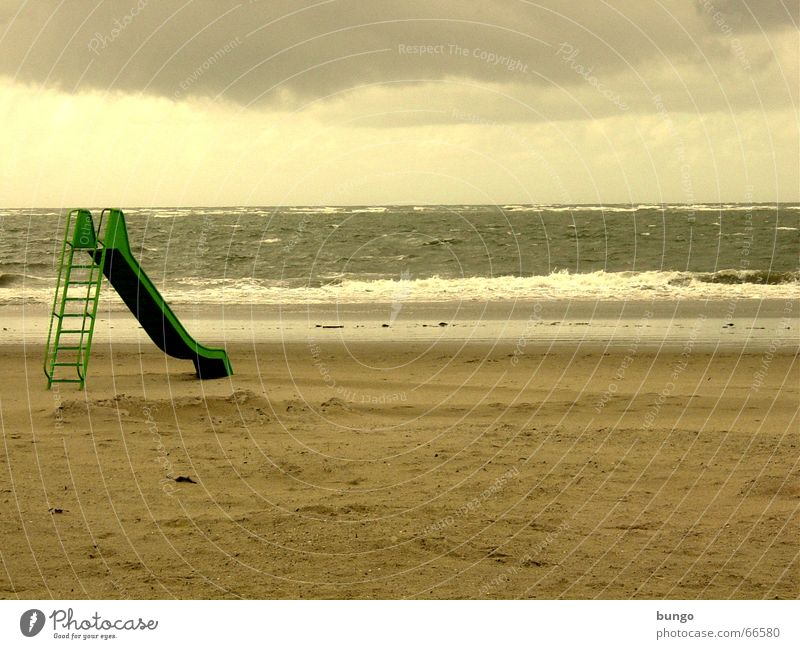 desiderium Langeoog Slide Green Brown Storm Clouds Ocean Lake Waves Beach Sandy beach Vacation & Travel Loneliness Boredom Playground Longing Peace Coast