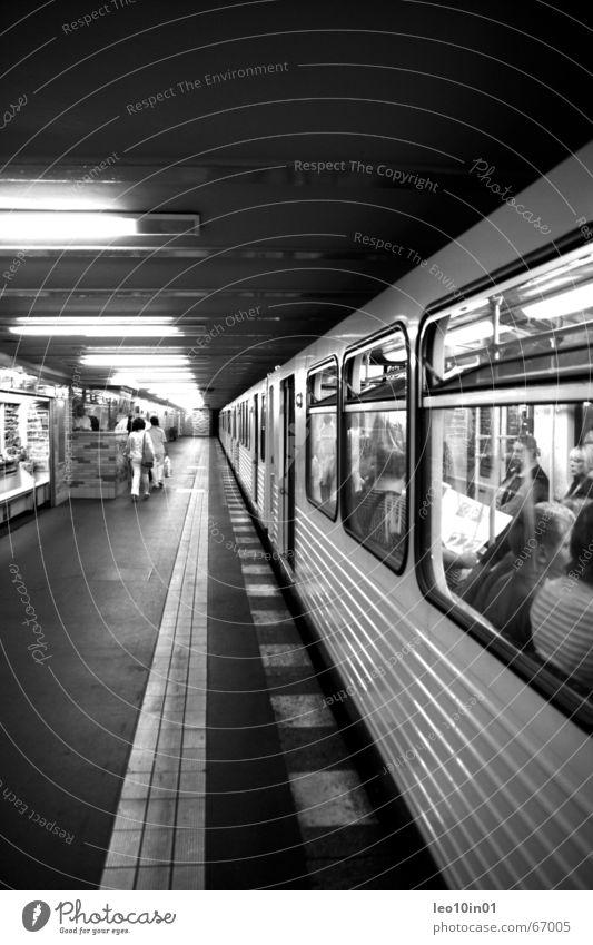 Underground Style Europe Government Haste Speed Railroad Station London Underground Globalization Dark Deep Light Black & white photo Railroad tracks Platform