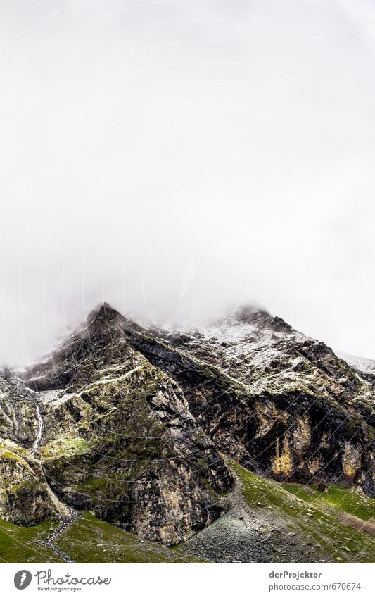 The mountain calls 03 Environment Nature Landscape Plant Elements Clouds Summer Climate Bad weather Snow Rock Alps Mountain Peak Snowcapped peak Esthetic Brown