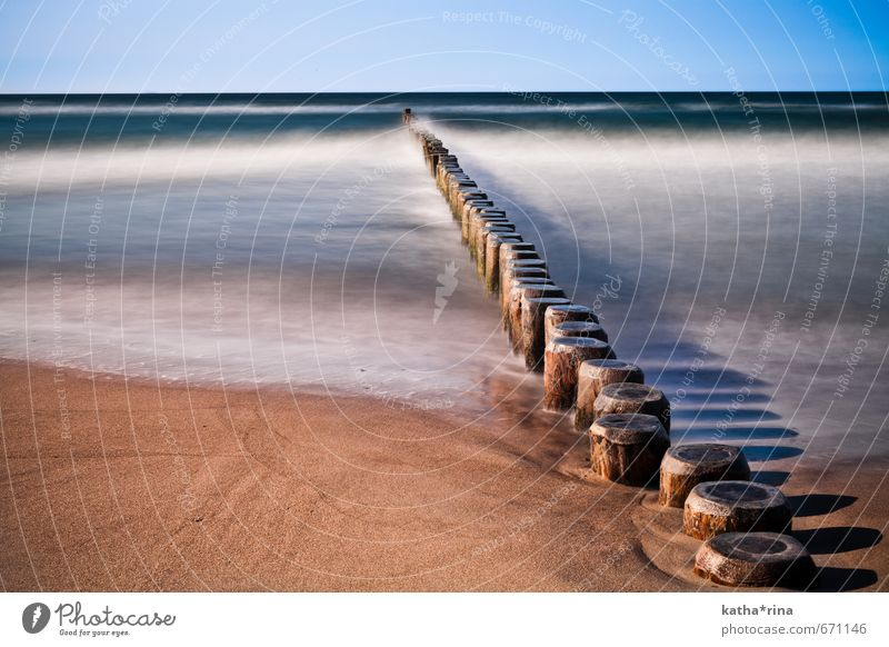 Noise . Cloudless sky Waves Beach Baltic Sea Ocean Warnemünde breakwater Sand Wood Relaxation Blue Brown Gold Calm Movement Horizon Idyll Colour photo