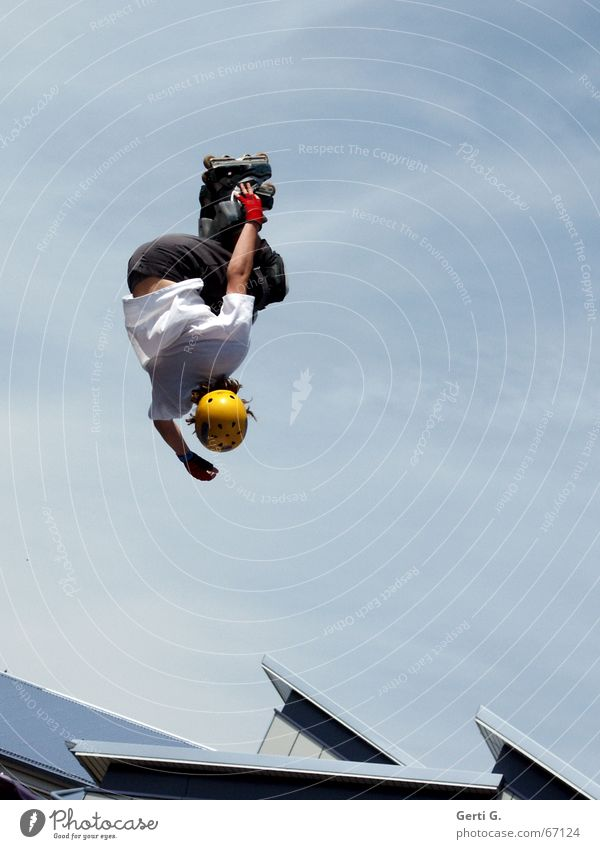 comin' down Inline skates Helmet Sports helmet Sky blue Clouds Inverted Driver Man Young man Jump Stunt Roof aggressive skating Beautiful weather Downward