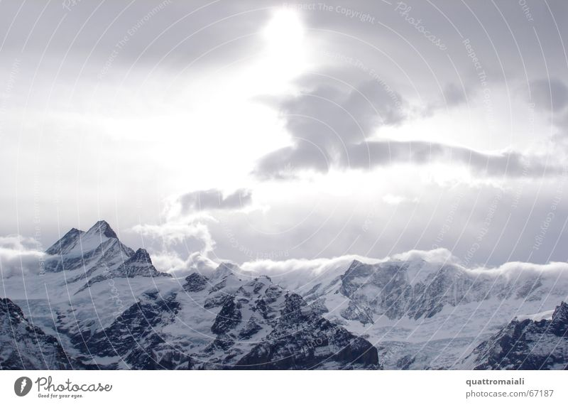 winter sun Winter Clouds Peak Grindelwald Switzerland Light Cold Glacier Sun Alps Snow difuse light Mountain Rock Ice
