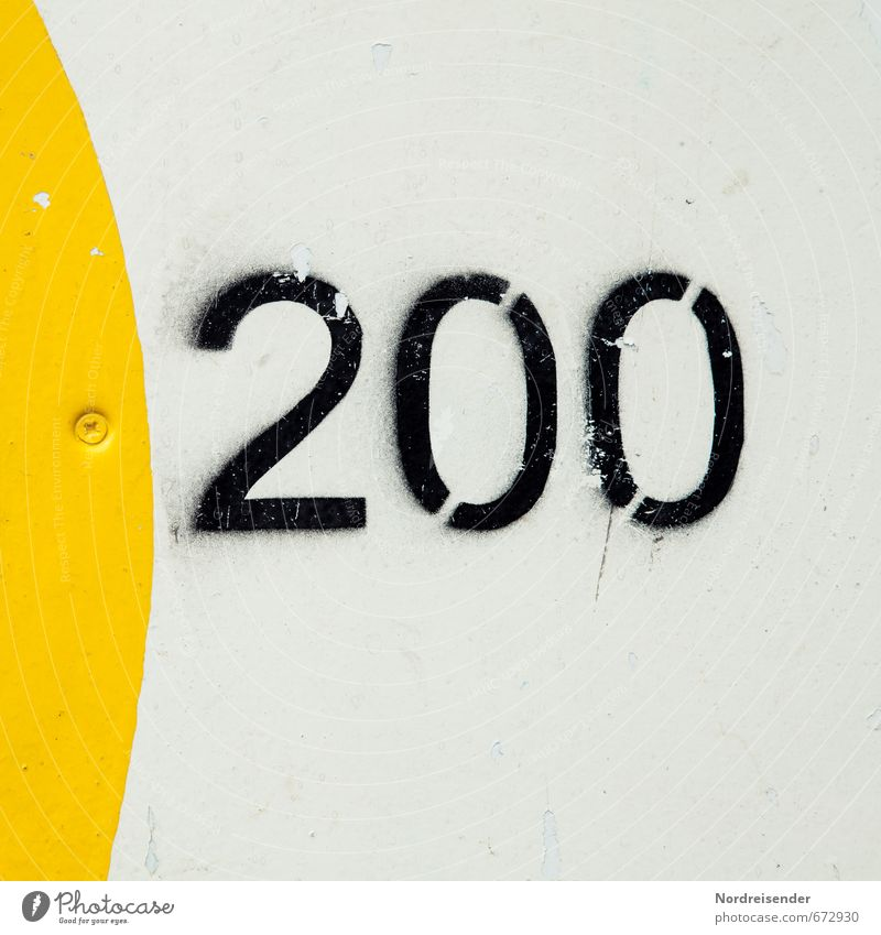 Of course.... Playing Game of chance Wall (barrier) Wall (building) Sign Digits and numbers Signs and labeling Speed Yellow Black White 200 two hundred