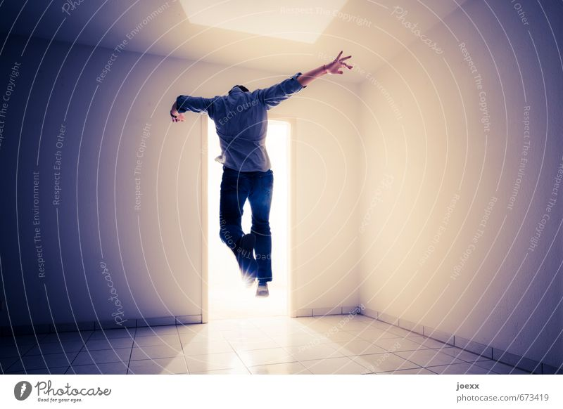 Human being Man Blue White Black Adults Wall (building) Movement Wall (barrier) Bright Jump Brown Dream Power Hope Target