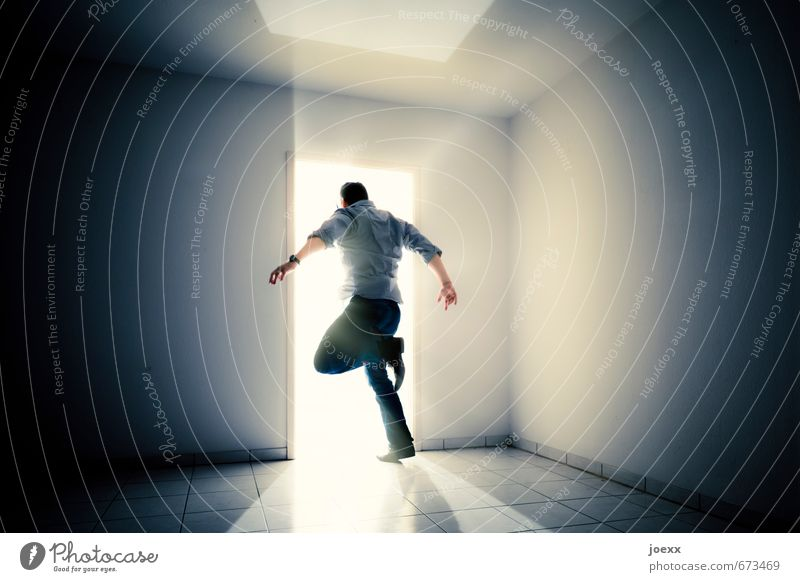 Man boldly jumps into the light Masculine Adults Body 1 Human being Wall (barrier) Wall (building) Running Walking Jump Bright Positive Black White Moody