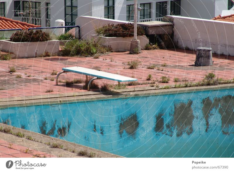 Springboard into the dry Swimming pool Roof Derelict Dry Portugal Turquoise Bleached Unused Vacation & Travel Refreshment Physics Refrigeration Hotel Wellness