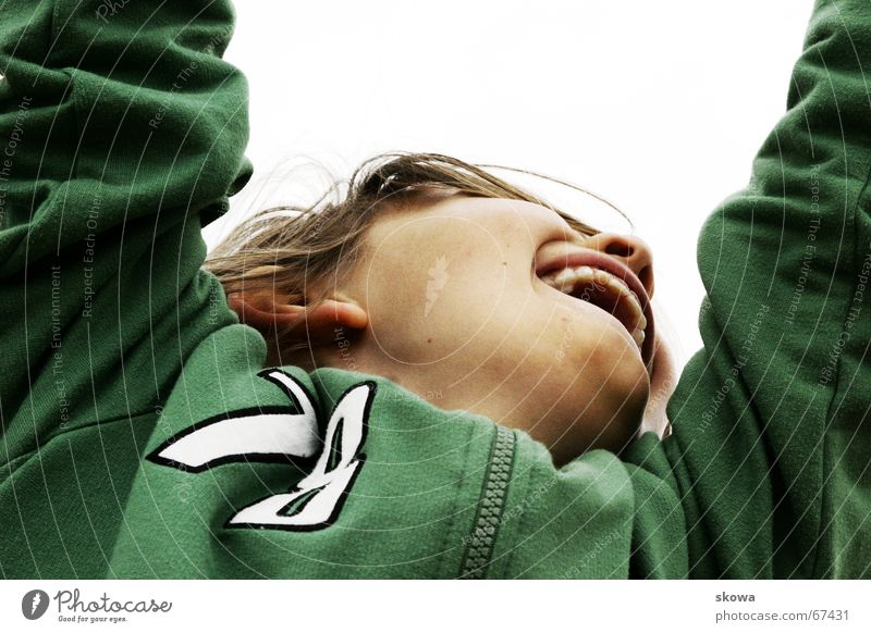 hang Hang Playground Worm's-eye view Green Child Blonde Jacket Playing climbing scaffold Joy Mouth Boy (child) Teeth